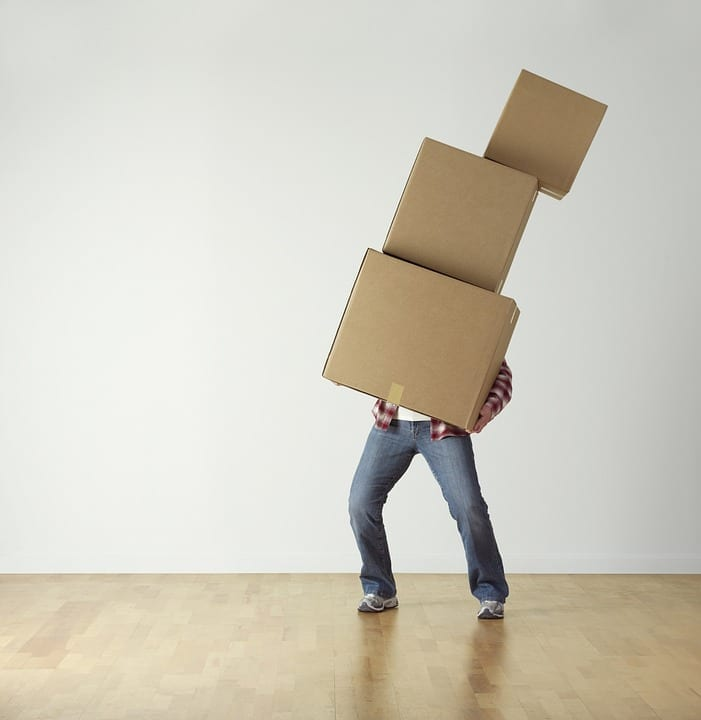Packaging materials - 10 things to remember when moving home - person carrying boxes
