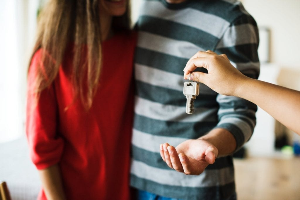 Collect all keys - 10 things to remember when moving home - person handing keys over