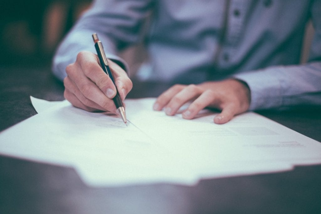 Brief the new owners - 10 things to remember when moving home - signing documents