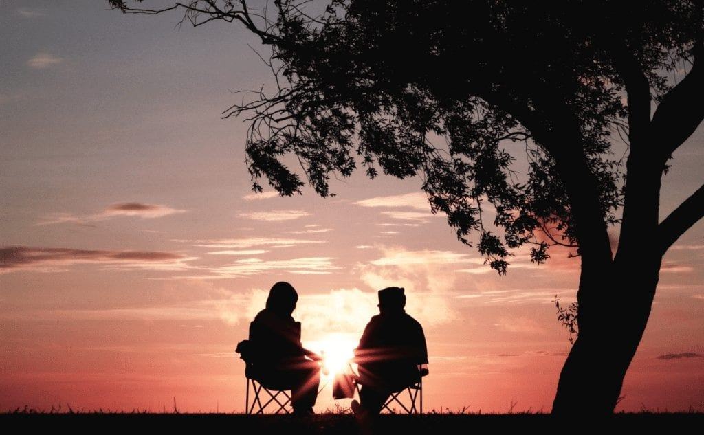 Couple looking at sunset for downsizing blog
