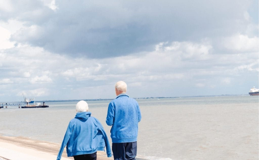 Older couple by the sea for downsizing blog