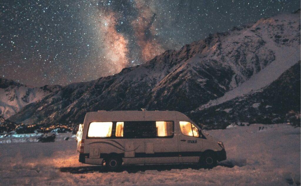 Caravan parked in snowy mountains for winter caravan storage blog