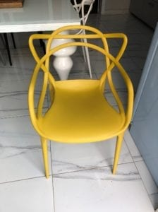 A yellow Philippe Starck chair for the Desert Island Desks blog