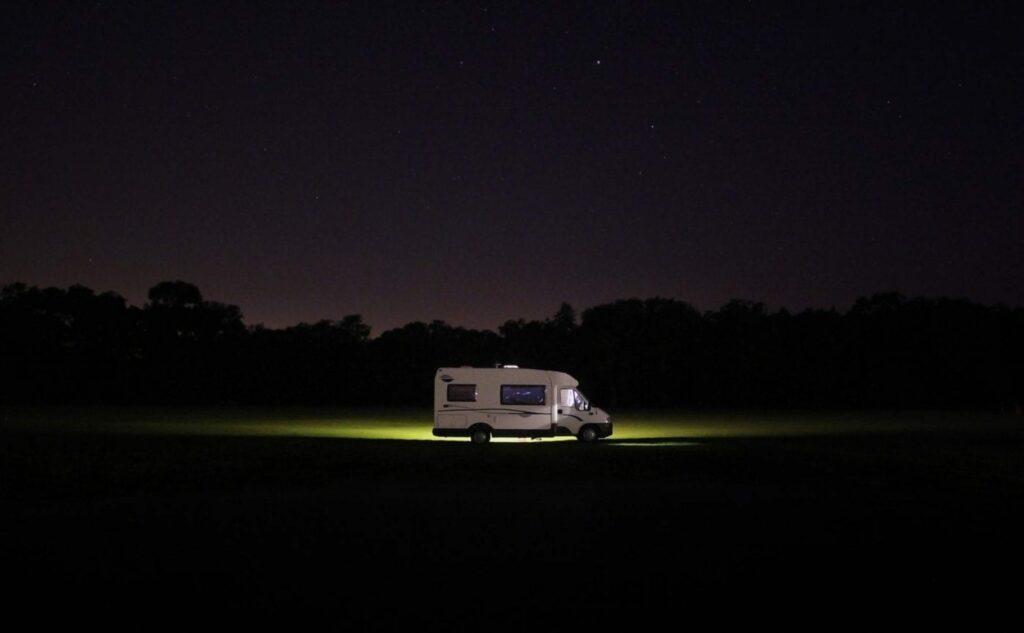 Caravan parked in a field at night for winter caravan storage blog