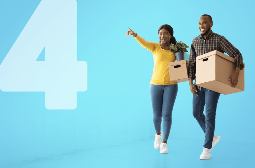 Couple walking happy with boxes - introducing breezybox by blue self storage